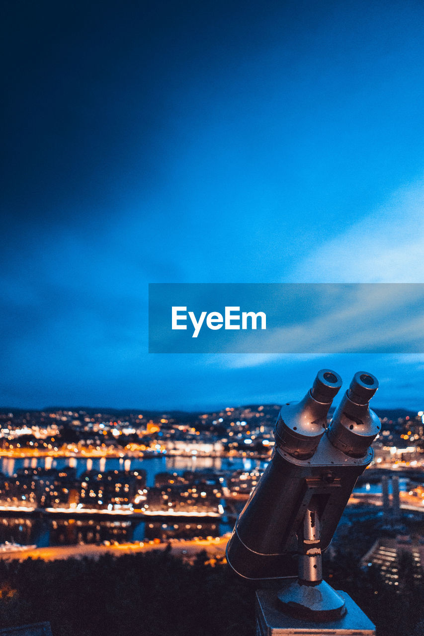 cityscape, building exterior, sky, architecture, city, built structure, binoculars, coin operated, coin-operated binoculars, nature, no people, cloud - sky, blue, night, building, outdoors, illuminated, residential district, astronomy, hand-held telescope