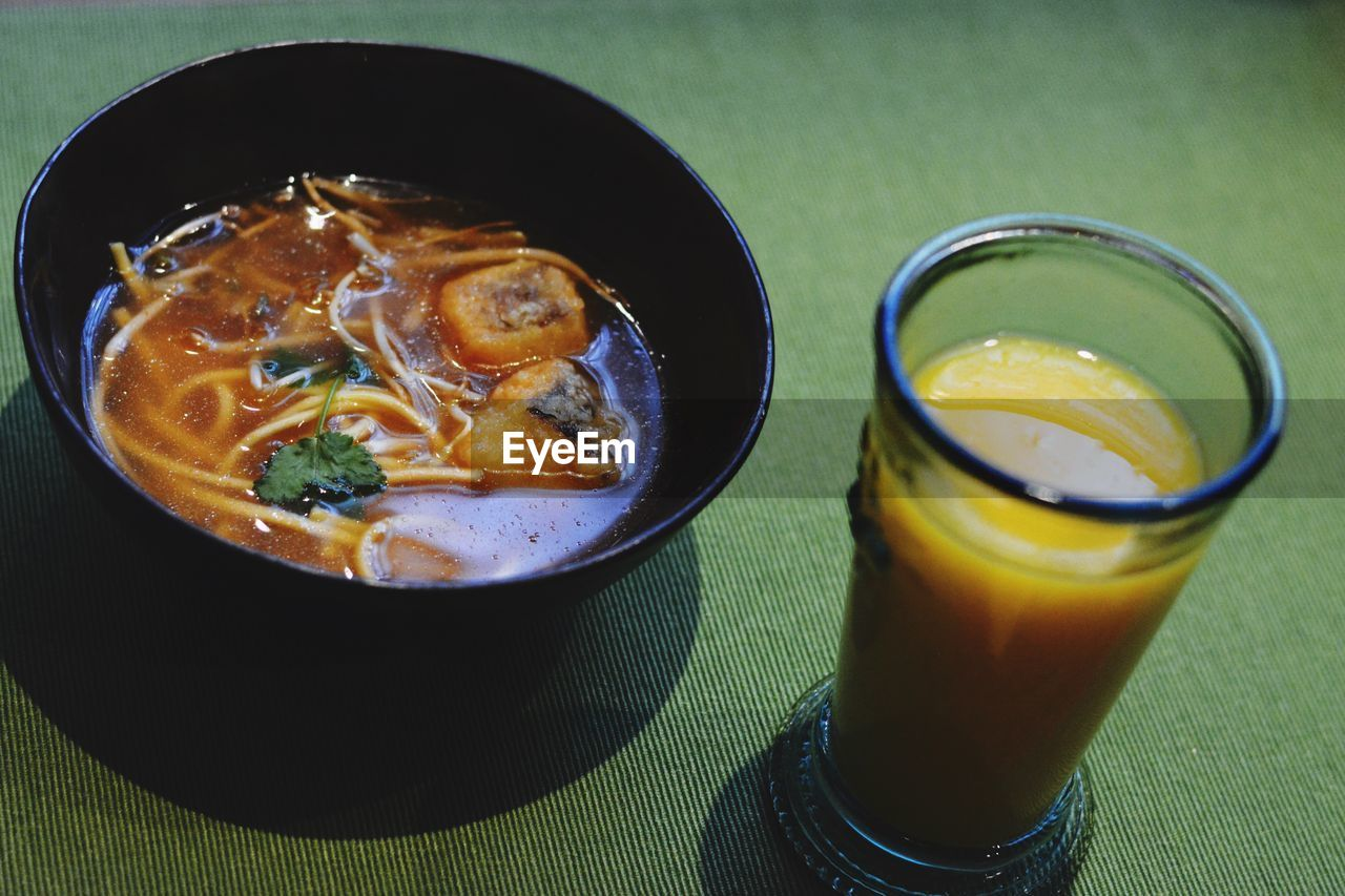 food and drink, table, freshness, healthy eating, high angle view, still life, indoors, food, serving size, drink, ready-to-eat, no people, bowl, drinking glass, soup, close-up, day