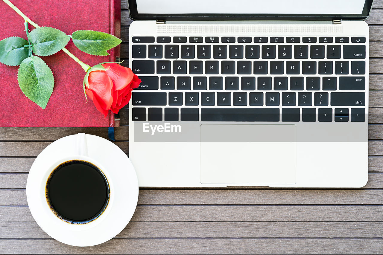 drink, table, coffee, cup, refreshment, coffee - drink, mug, computer, technology, keyboard, food and drink, coffee cup, laptop, directly above, freshness, computer keyboard, plant, communication, flower, no people, wireless technology