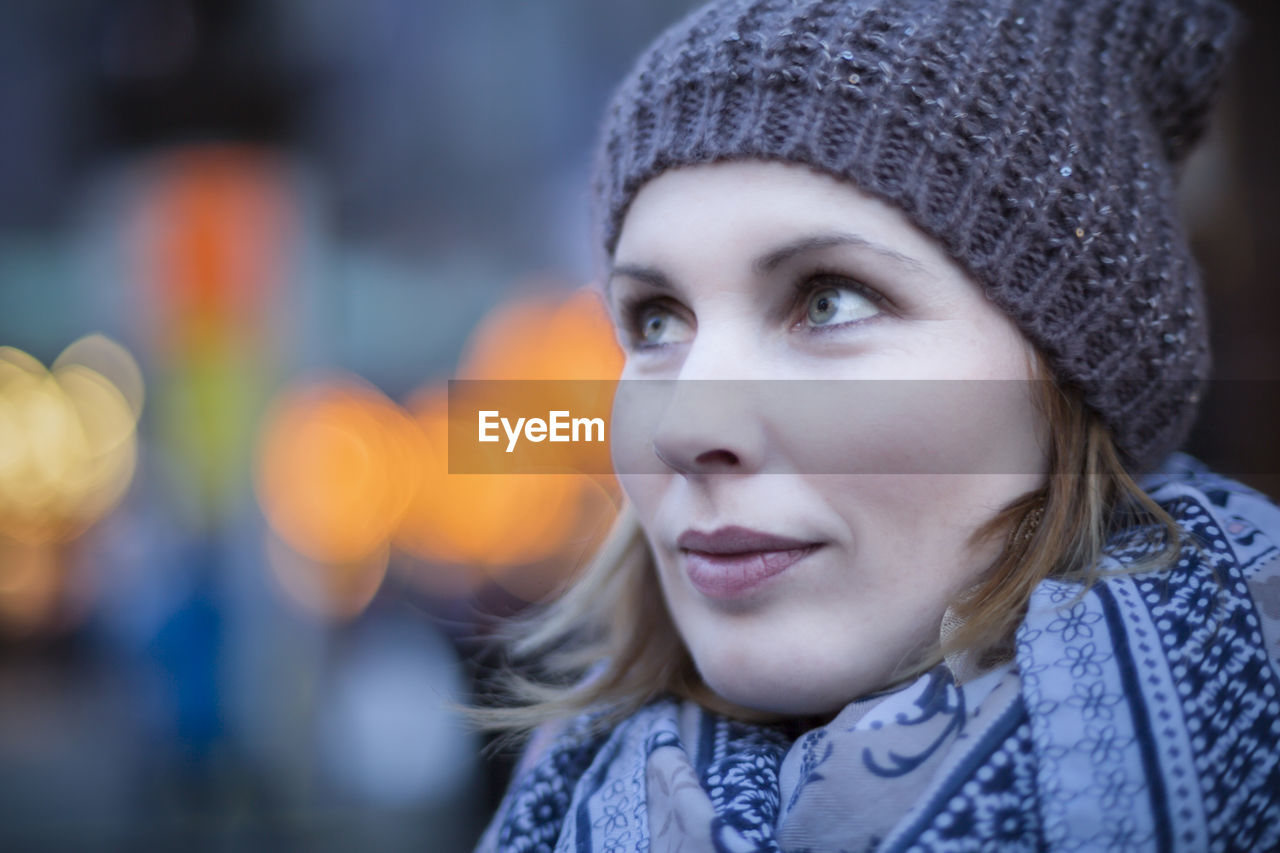 headshot, hat, portrait, knit hat, young adult, focus on foreground, one person, clothing, warm clothing, close-up, winter, young women, real people, women, lifestyles, leisure activity, looking, cold temperature, beautiful woman, outdoors, hairstyle, human face, scarf