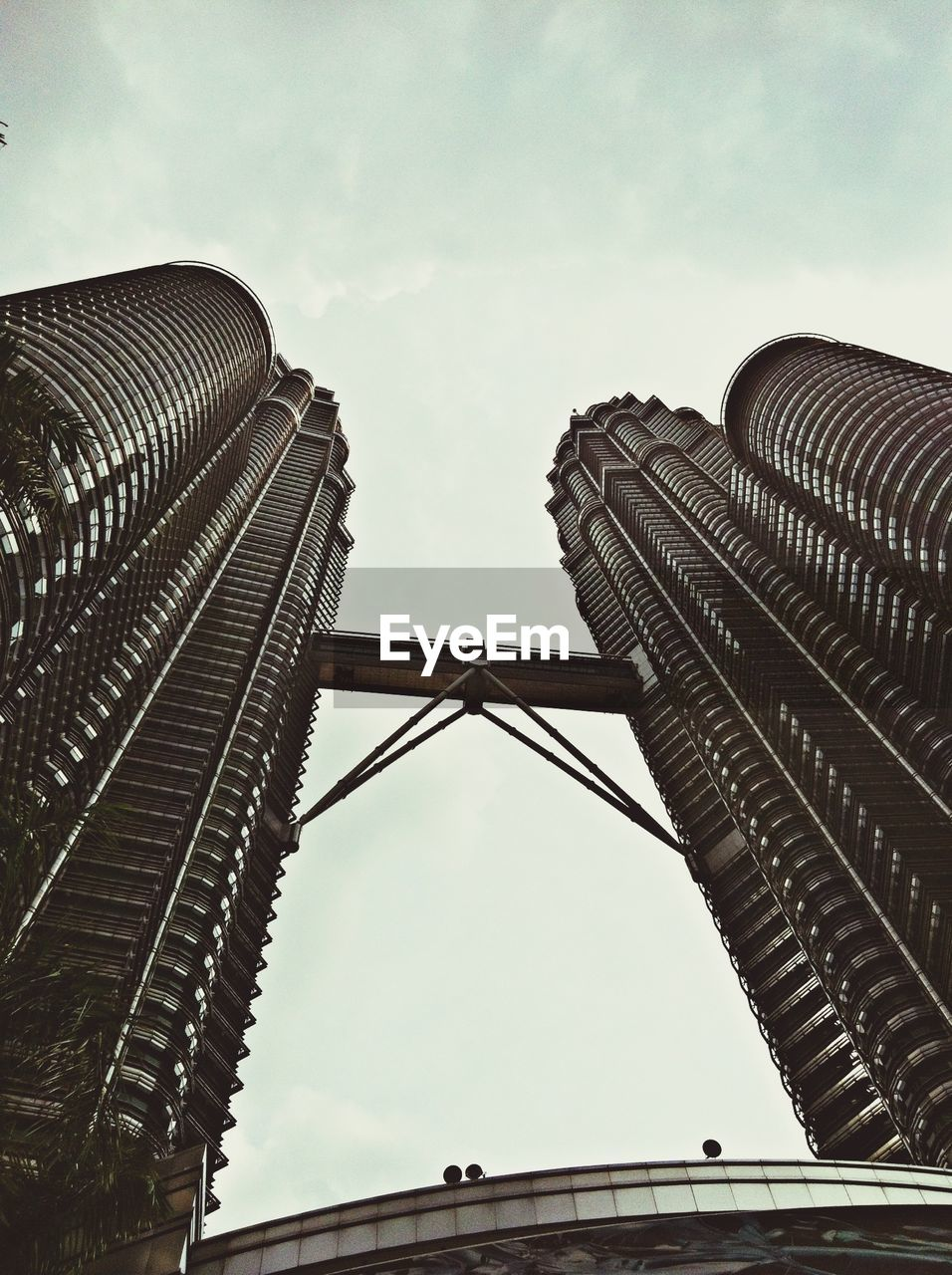 low angle view, architecture, sky, built structure, building exterior, outdoors, no people, day, city, travel destinations, skyscraper, modern