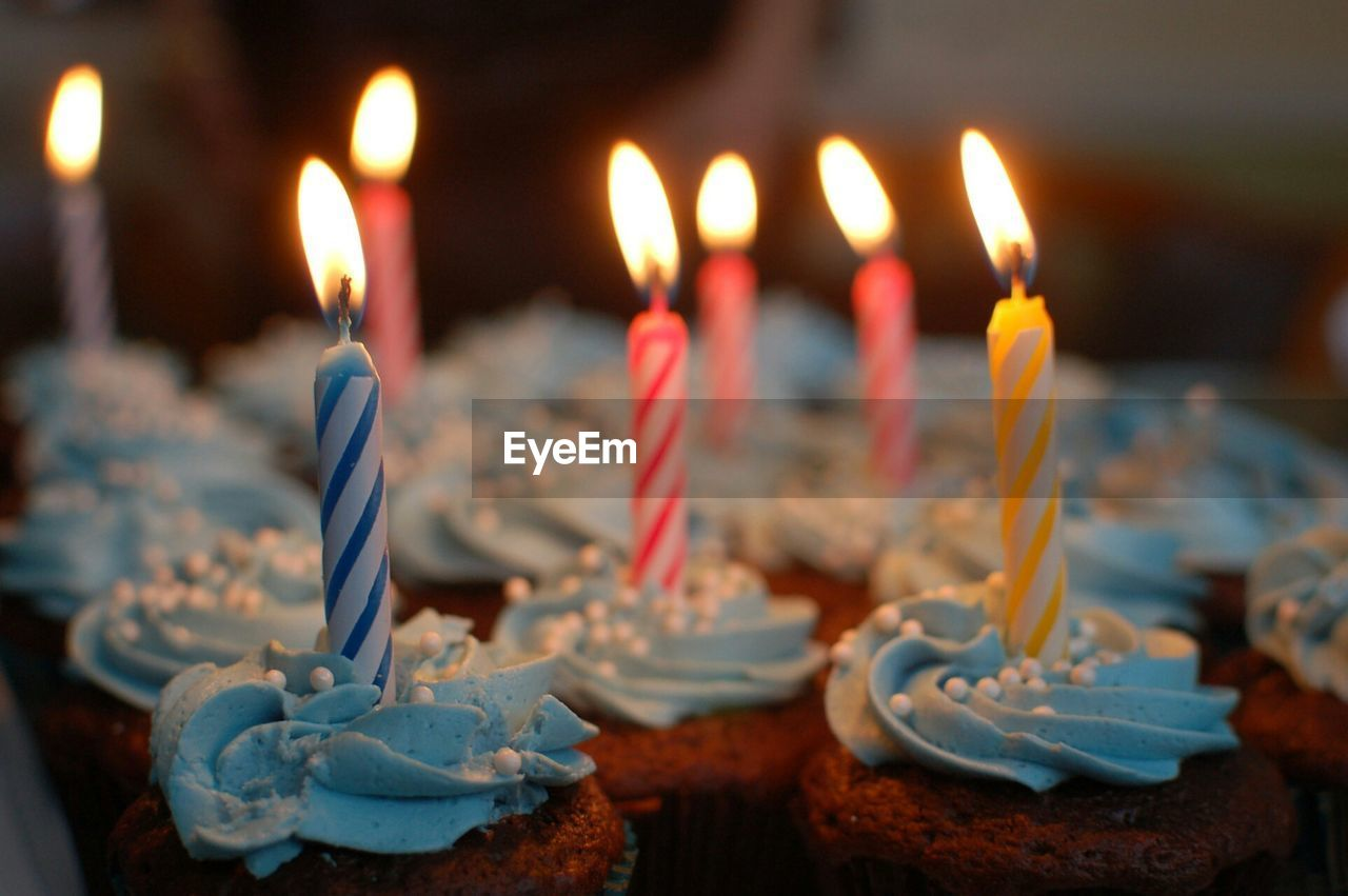 Close-Up Of Candles On Cake