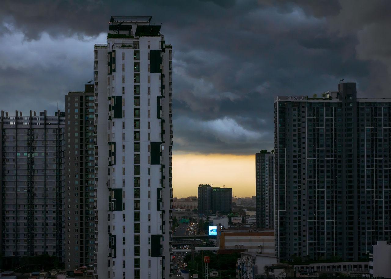 MODERN BUILDINGS AGAINST SKY AT DUSK