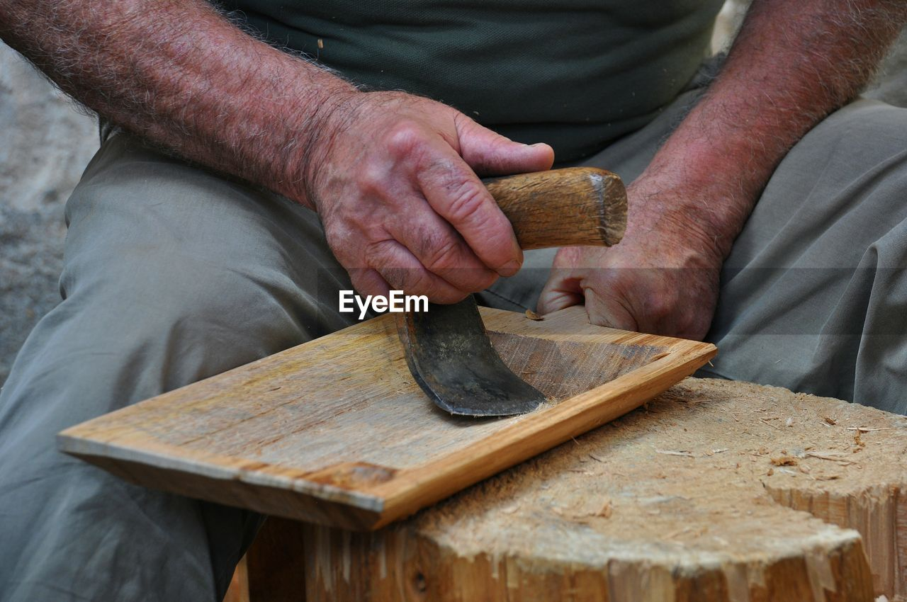 Midsection Of Man Working