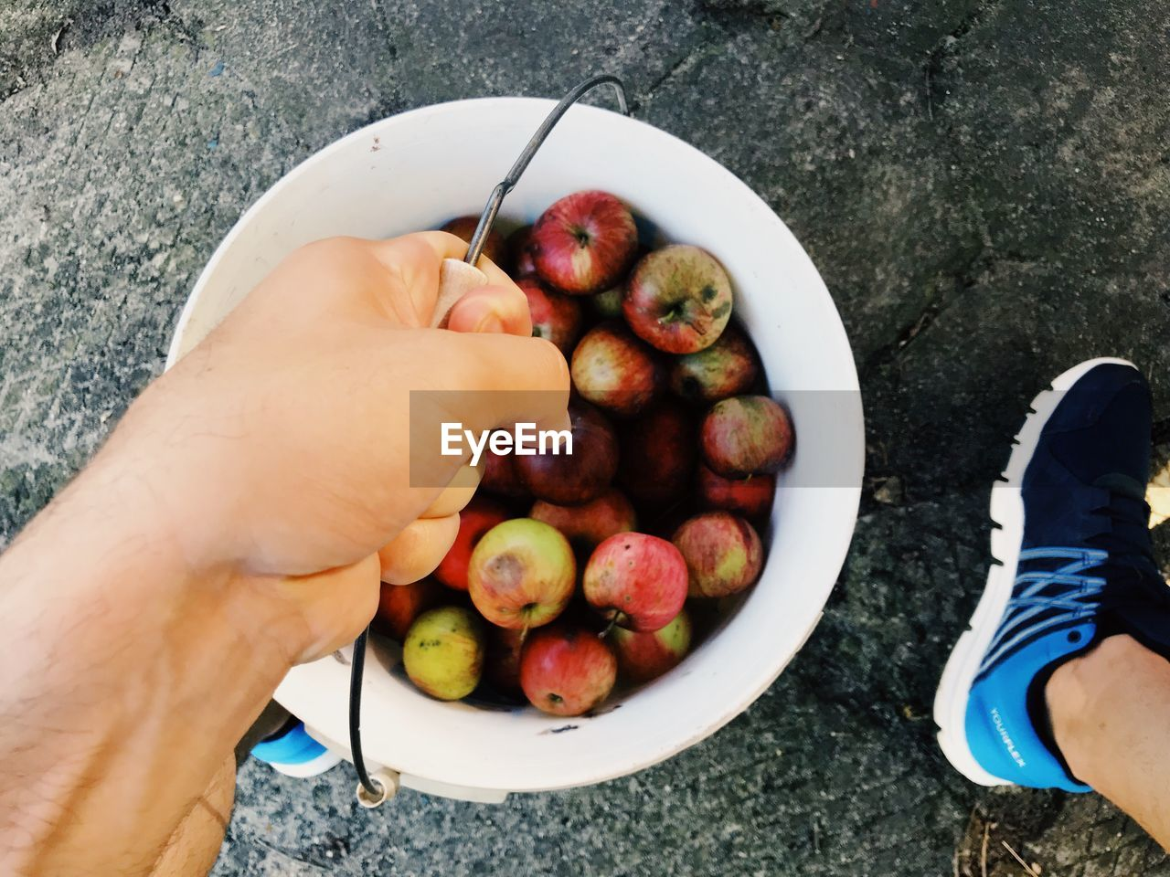 healthy eating, food and drink, food, real people, human body part, human hand, fruit, wellbeing, one person, hand, personal perspective, holding, lifestyles, unrecognizable person, freshness, high angle view, body part, day, leisure activity, finger, outdoors, human foot, human limb