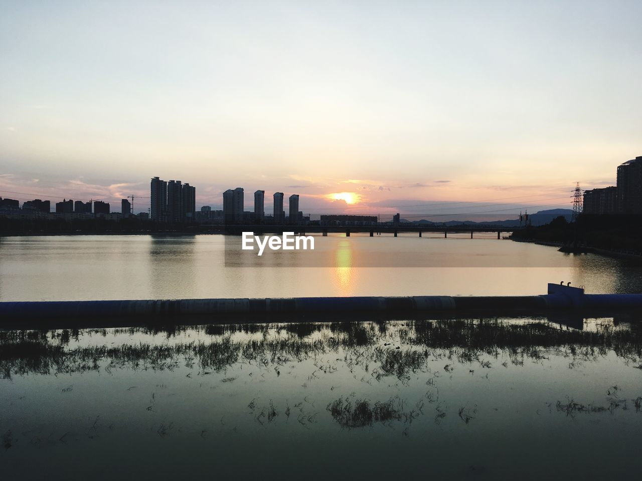 sky, water, architecture, built structure, building exterior, sunset, city, reflection, nature, building, no people, waterfront, river, urban skyline, landscape, beauty in nature, cloud - sky, scenics - nature, outdoors, cityscape, office building exterior, skyscraper