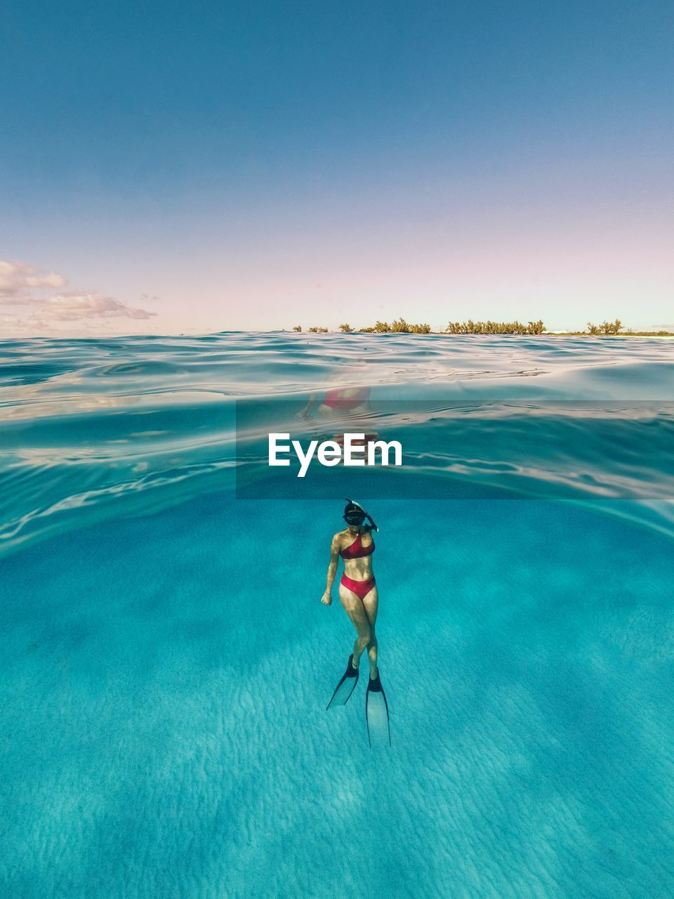 sea, water, one person, beauty in nature, leisure activity, swimwear, real people, lifestyles, blue, sky, nature, aquatic sport, adventure, underwater, bikini, sport, holiday, vacations, snorkeling, outdoors, undersea, turquoise colored
