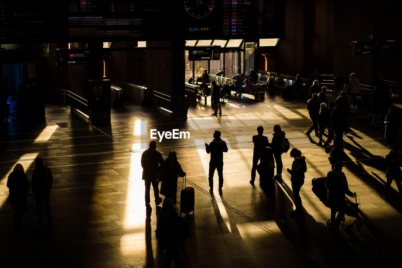 High angle view of silhouette people walking in airport