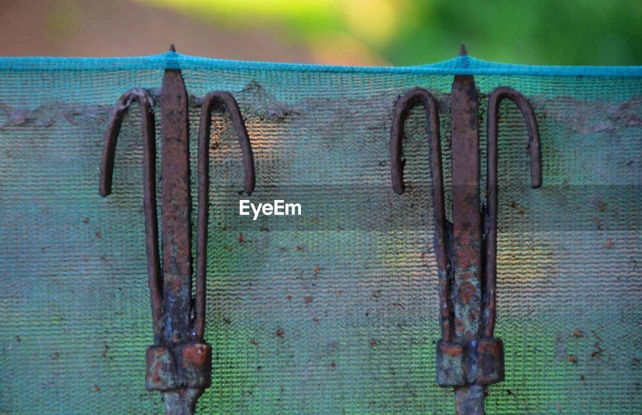 wood - material, old, no people, close-up, rusty, metal, day, weathered, focus on foreground, brown, protection, outdoors, safety, security, textured, decline, run-down, hanging, deterioration, communication