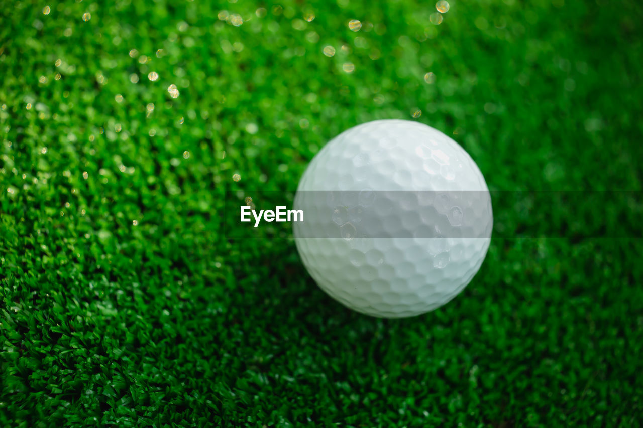 golf ball, golf, sport, golf course, ball, green - golf course, grass, green color, putting green, sports equipment, competition, tee, no people, close-up, competitive sport, golf club, day, outdoors
