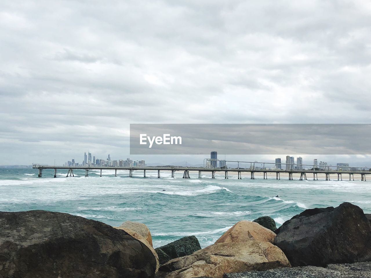water, cloud - sky, sky, architecture, built structure, nature, building exterior, no people, sea, rock, city, day, rock - object, solid, bridge, scenics - nature, beauty in nature, bridge - man made structure, outdoors, cityscape, office building exterior, skyscraper