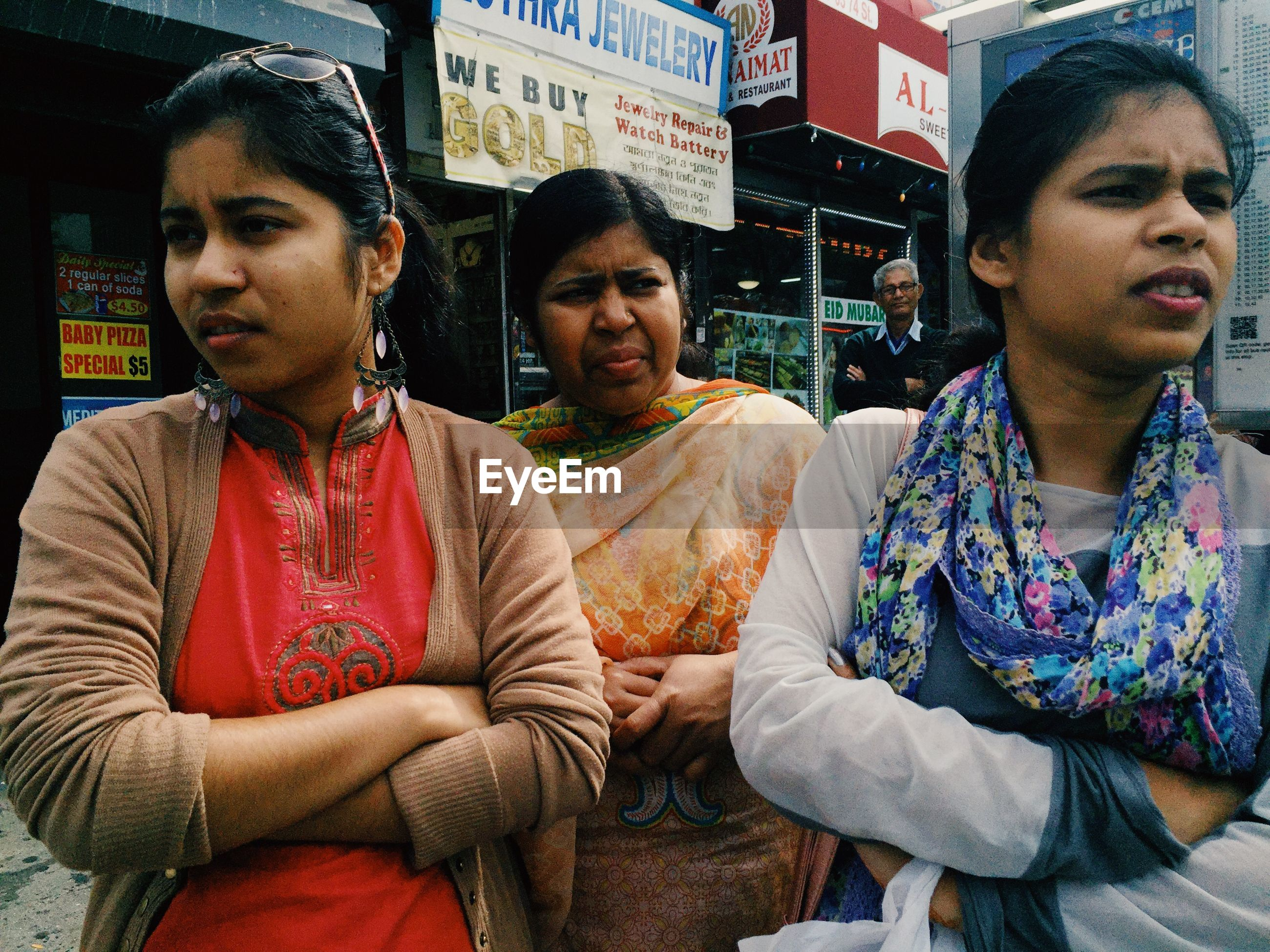 real people, traditional clothing, front view, sari, casual clothing, leisure activity, sitting, lifestyles, young adult, young women, young men, outdoors, two people, women, day, men, people
