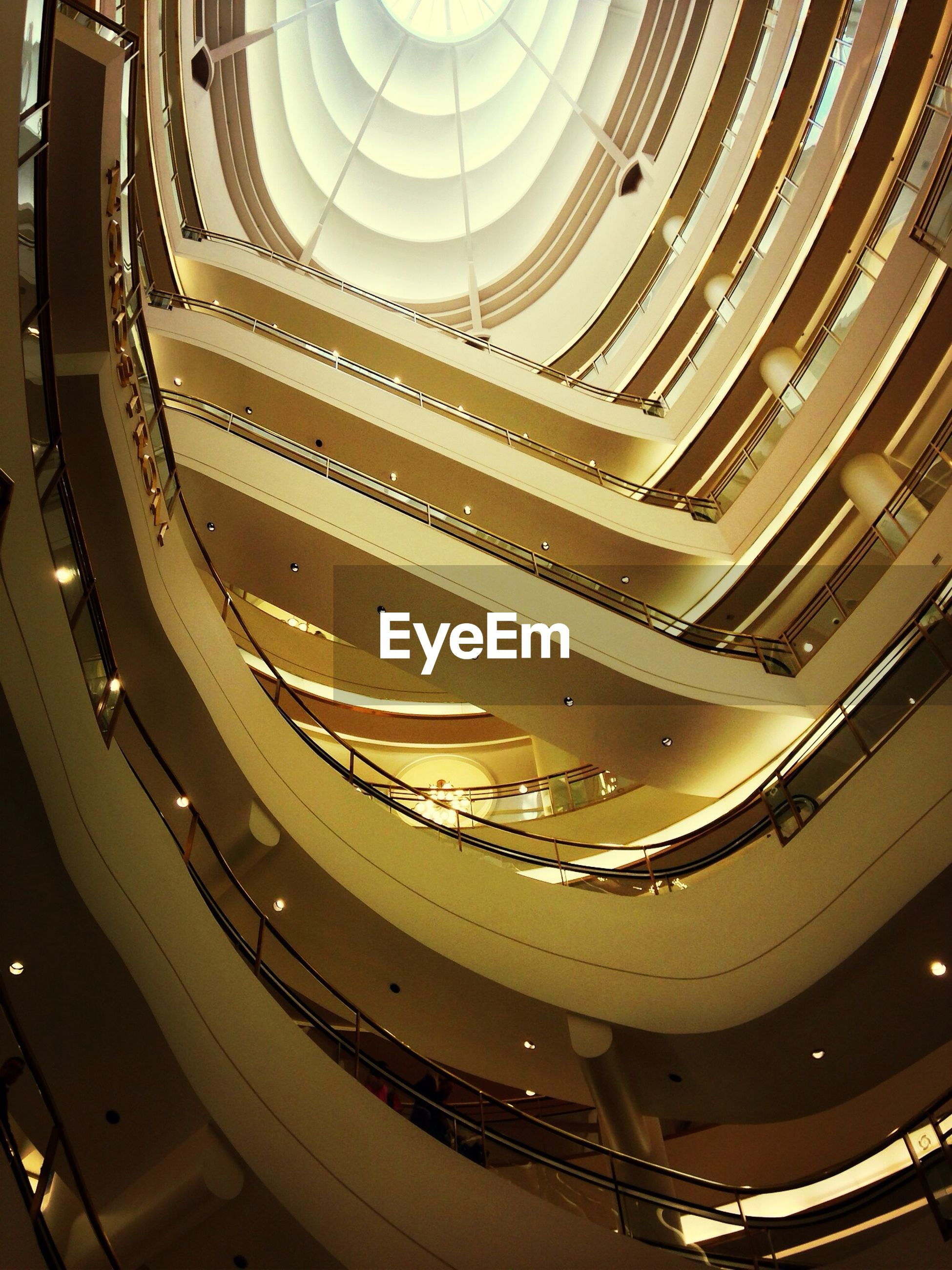 indoors, architecture, built structure, ceiling, staircase, steps and staircases, high angle view, pattern, steps, spiral, low angle view, architectural feature, railing, design, repetition, spiral staircase, modern, in a row, famous place, no people