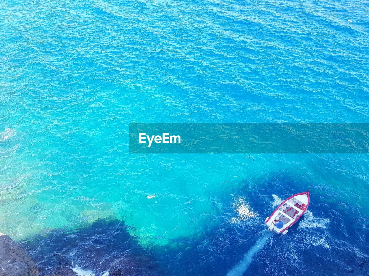 water, sea, high angle view, beauty in nature, blue, nature, day, nautical vessel, turquoise colored, no people, waterfront, outdoors, scenics - nature, wave pattern, tranquility, tranquil scene, remote, transportation, wake - water
