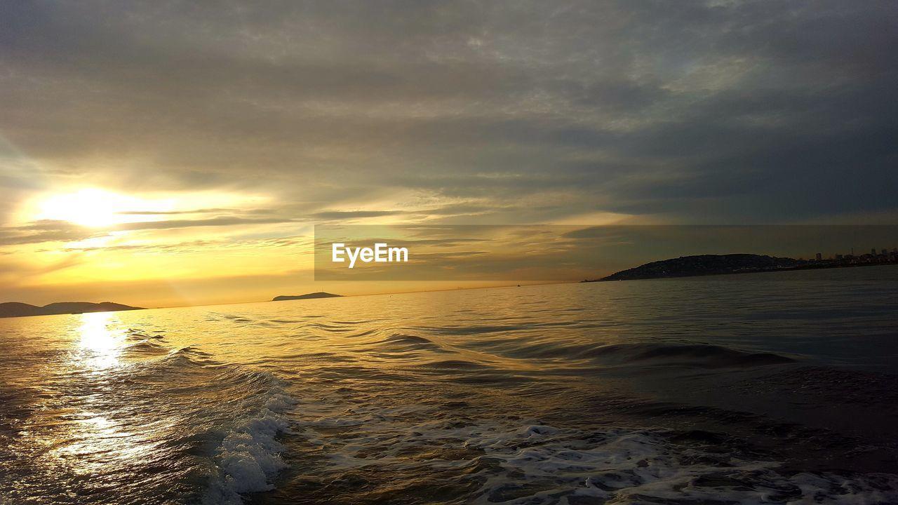 water, sunset, sky, sea, scenics - nature, cloud - sky, beauty in nature, tranquility, tranquil scene, land, horizon, horizon over water, idyllic, beach, nature, no people, waterfront, non-urban scene, outdoors