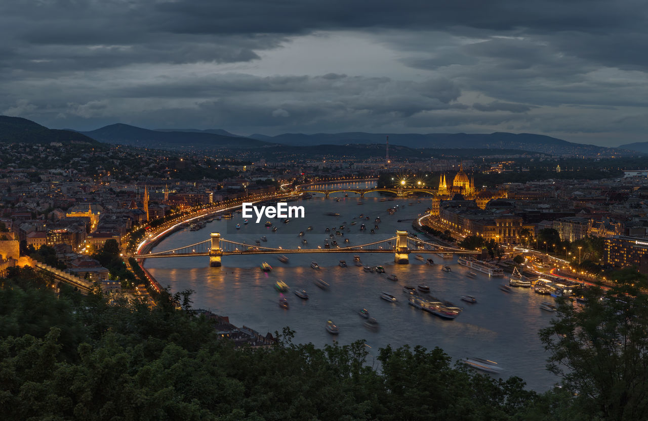 High angle view of szechenyi chain bridge over danube river in city at dusk