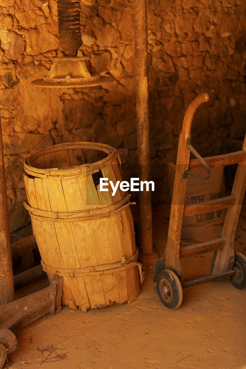 barrel, indoors, old, wood - material, cylinder, cellar, wine cask, architecture, container, no people, cart, wall, abandoned, wine, wine cellar, storage, building, metal, wheel, wall - building feature, winemaking, stone wall