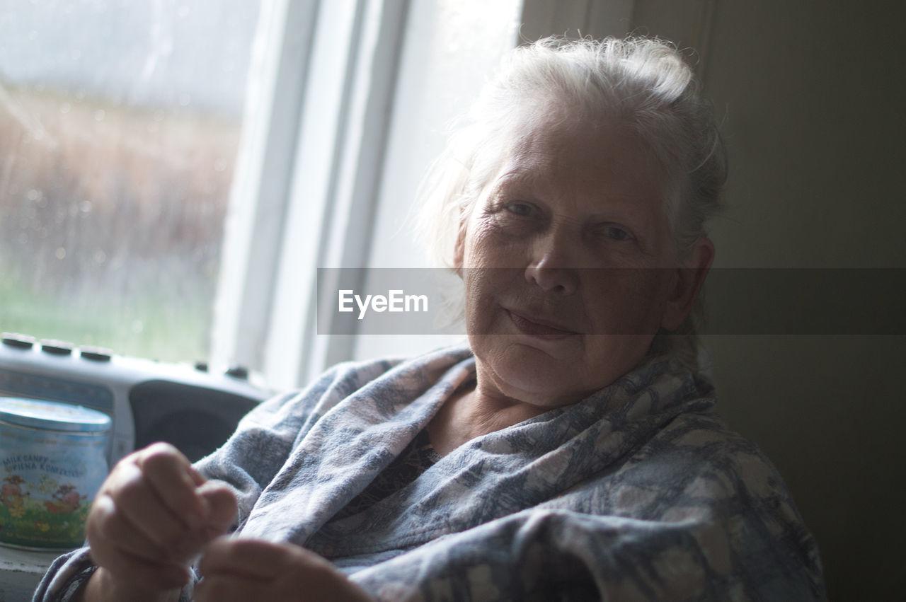 Close-Up Of Woman Looking At Camera