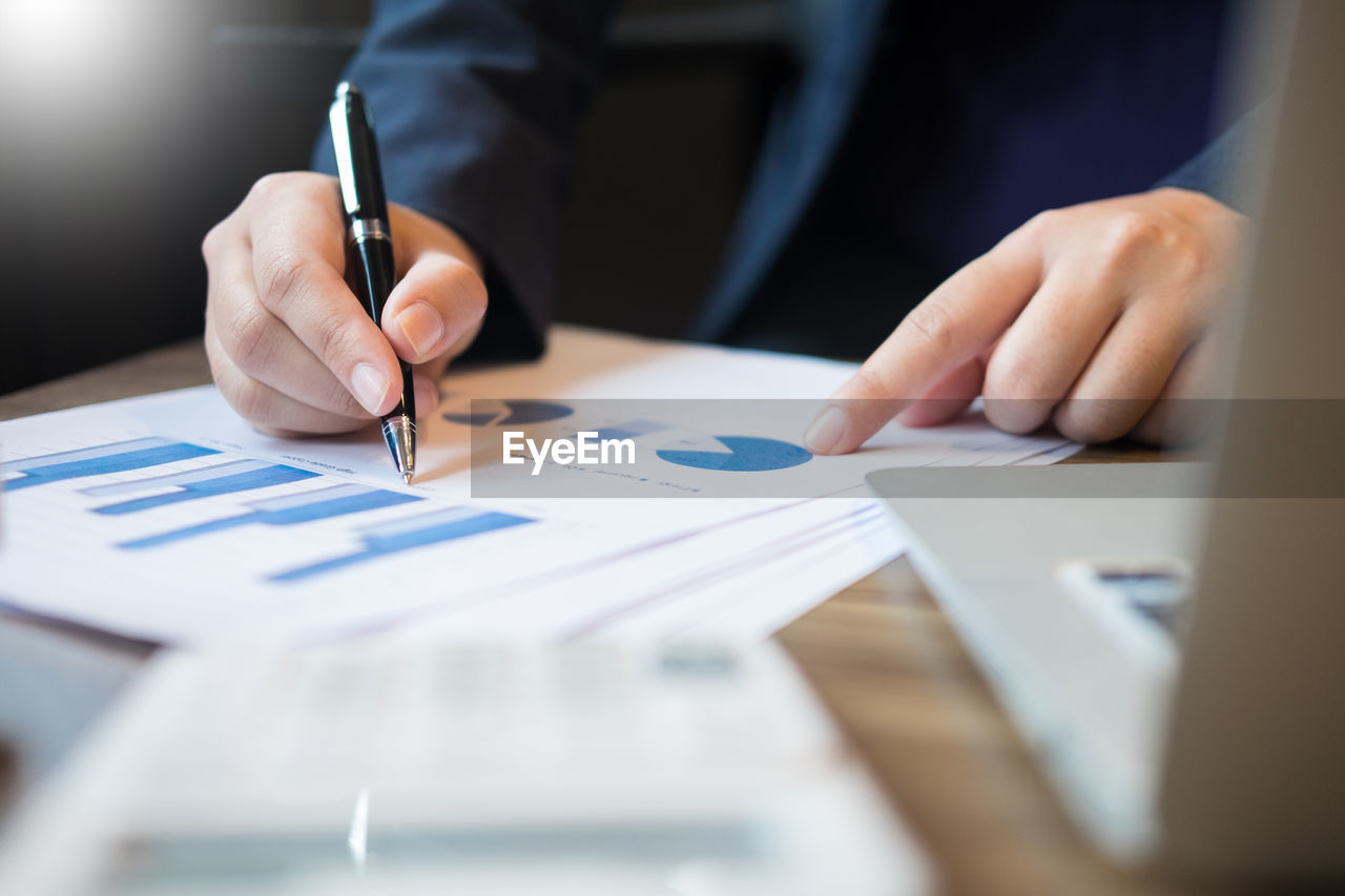 Cropped image of businessman working in office