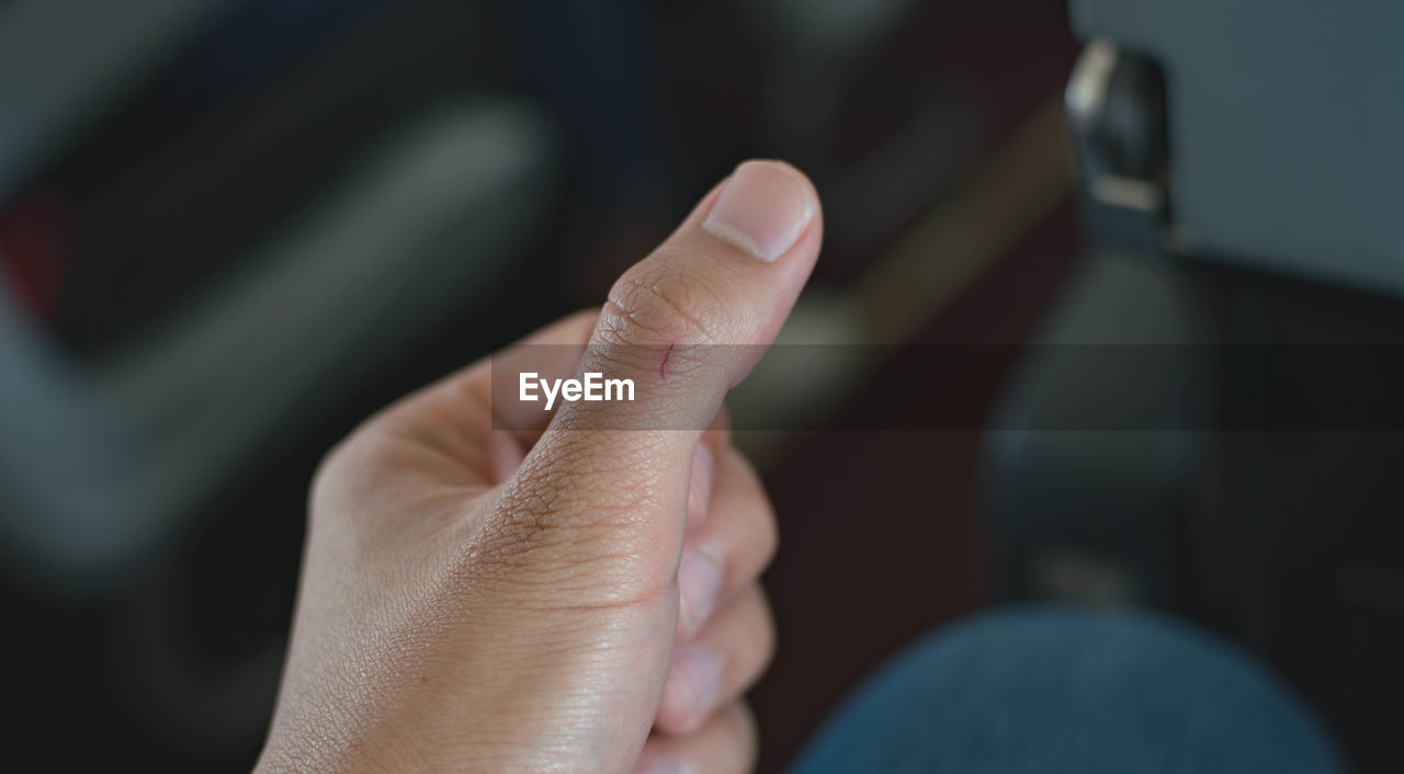 human hand, human body part, hand, body part, human finger, finger, real people, one person, lifestyles, selective focus, gesturing, leisure activity, personal perspective, close-up, men, unrecognizable person, focus on foreground, communication, day