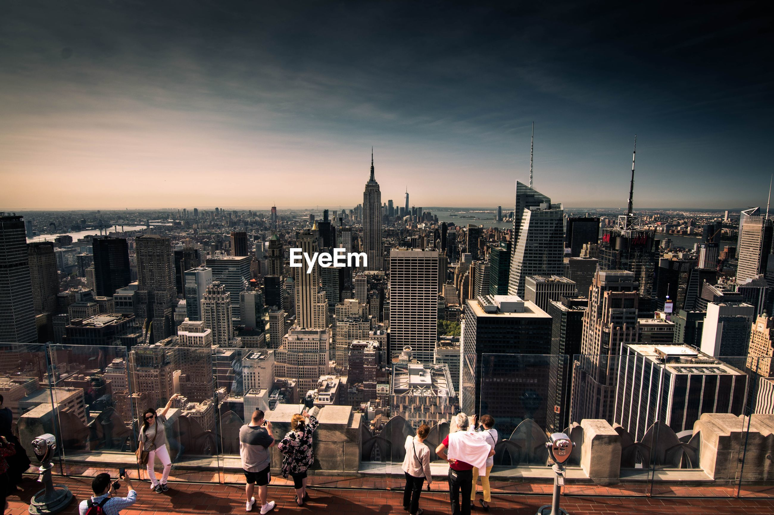 High angle view of people looking at cityscape