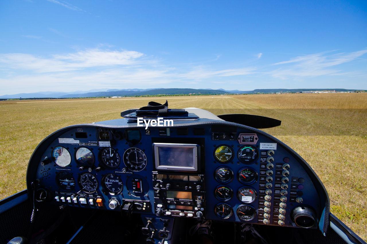 Landscape seen through window of propeller airplane
