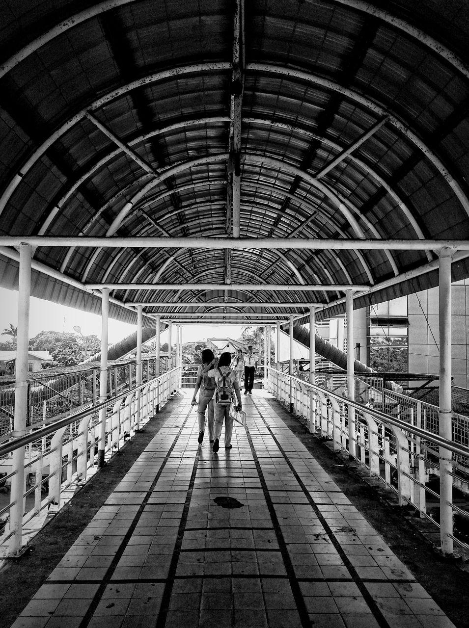 People on covered footbridge