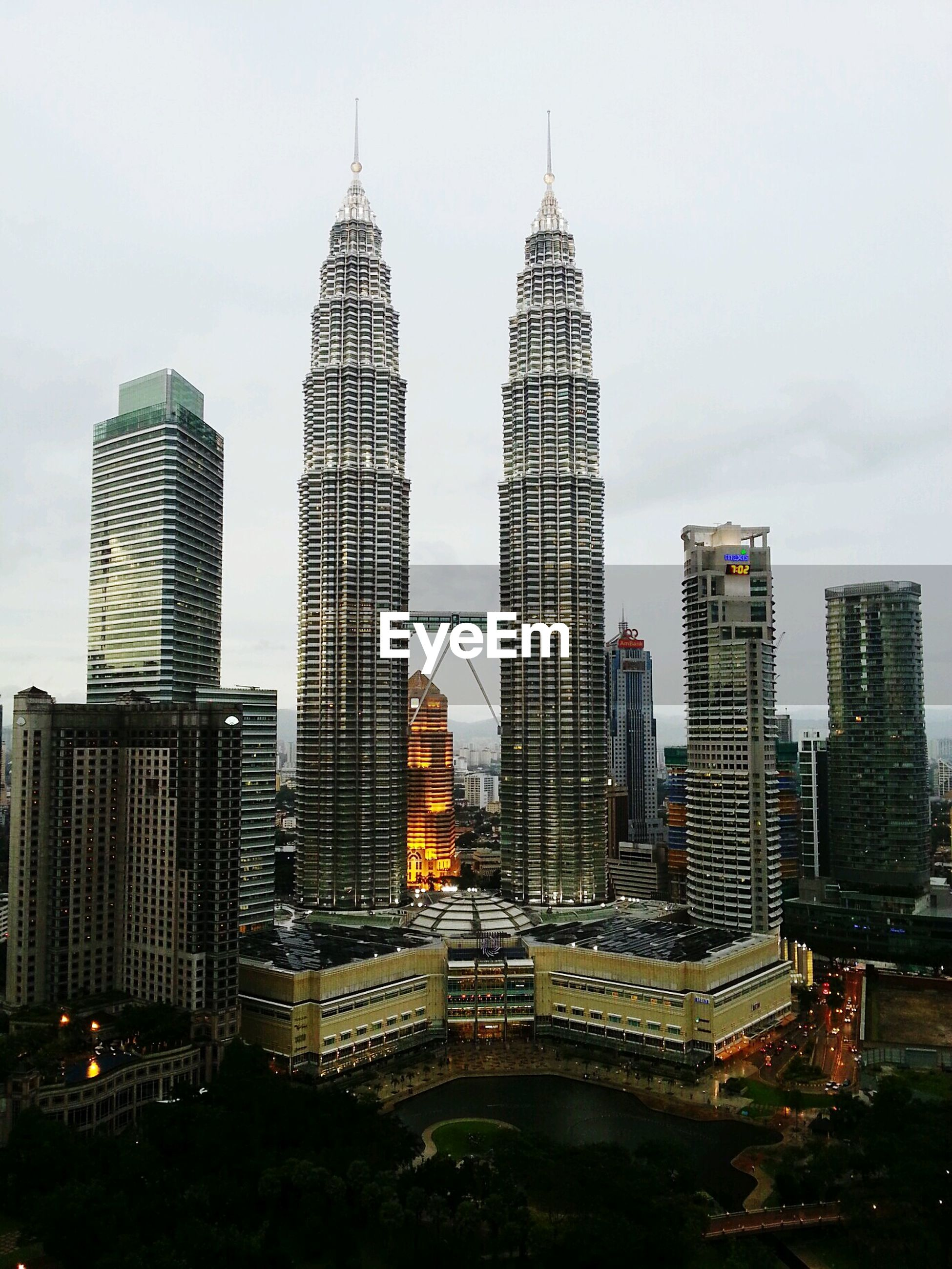 Petronas towers in city against sky