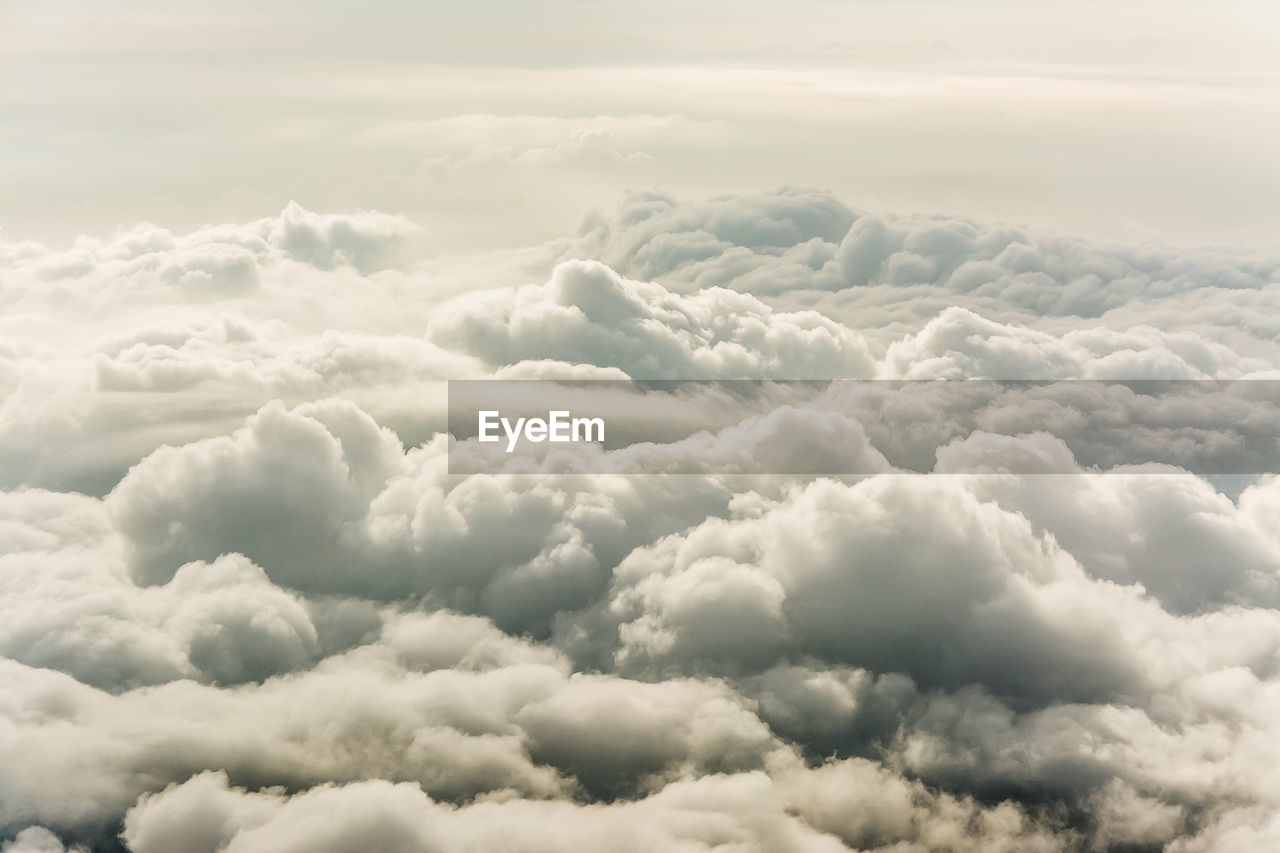 cloud - sky, beauty in nature, sky, tranquility, scenics - nature, tranquil scene, no people, cloudscape, softness, fluffy, idyllic, nature, backgrounds, day, outdoors, dramatic sky, white color, overcast, full frame, meteorology, ominous