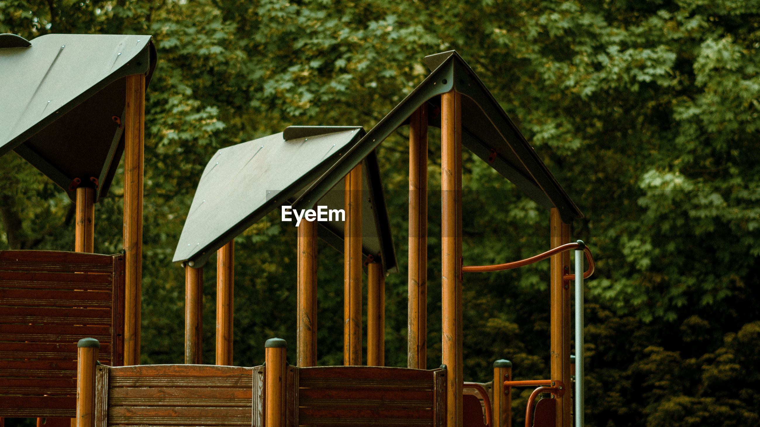Outdoor play equipment at playground against trees