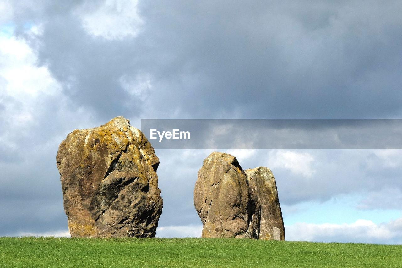 cloud - sky, sky, grass, land, nature, day, tranquil scene, no people, solid, tranquility, landscape, field, environment, rock, plant, scenics - nature, beauty in nature, green color, outdoors, rock - object
