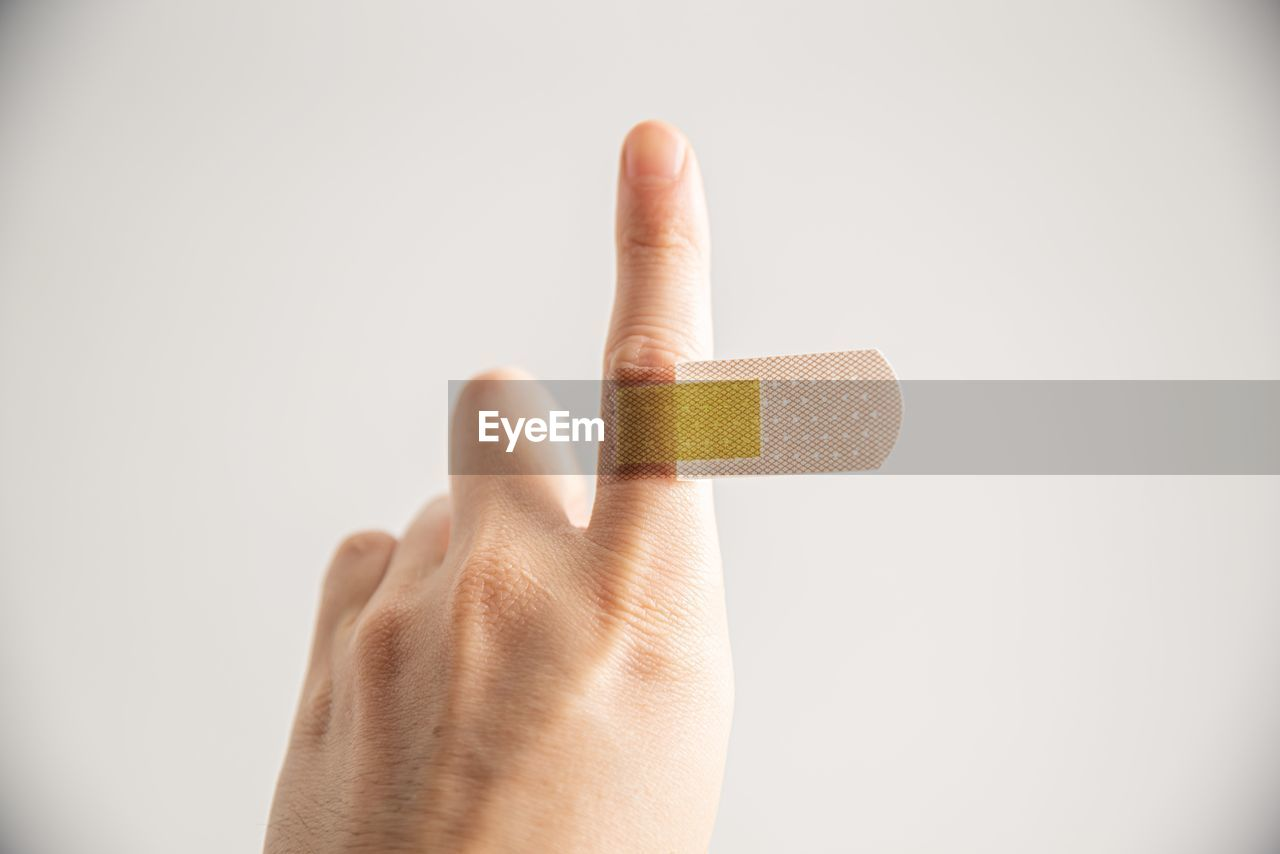 human hand, human body part, hand, human finger, finger, studio shot, one person, white background, indoors, unrecognizable person, body part, holding, copy space, close-up, gesturing, personal perspective, showing, single object, thumb