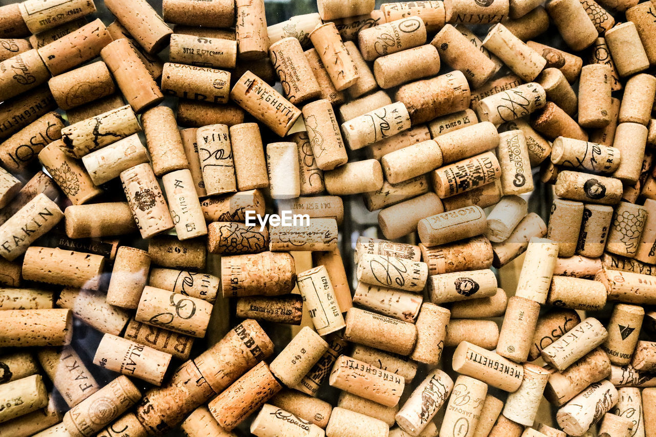 cork - stopper, wine cork, large group of objects, backgrounds, full frame, abundance, no people, alcohol, food and drink, drink, wine, refreshment, wood - material, still life, text, brown, indoors, close-up, pattern, shape, drinking