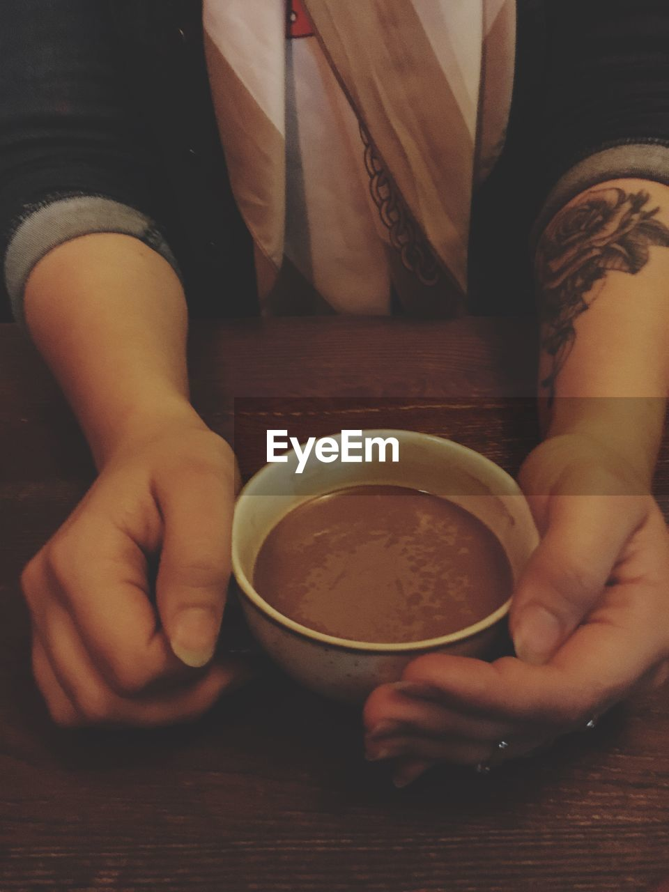 food and drink, indoors, holding, one person, table, human hand, real people, midsection, freshness, bowl, food, human body part, refreshment, drink, healthy eating, lifestyles, close-up, women, day, ready-to-eat, people