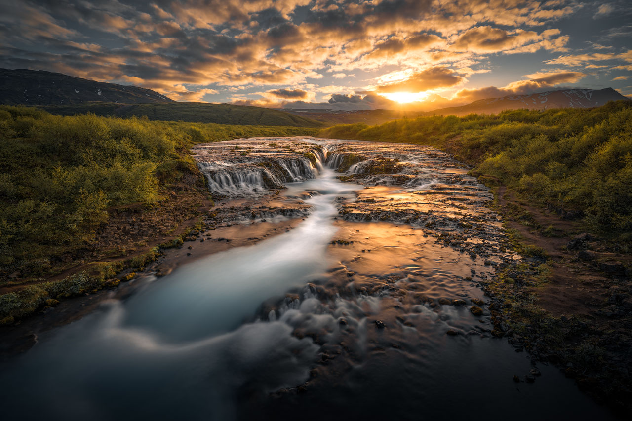 scenics - nature, water, beauty in nature, sunset, flowing water, sky, nature, long exposure, environment, blurred motion, cloud - sky, rock, waterfall, non-urban scene, idyllic, motion, rock - object, solid, land, no people, flowing, outdoors, power in nature, stream - flowing water