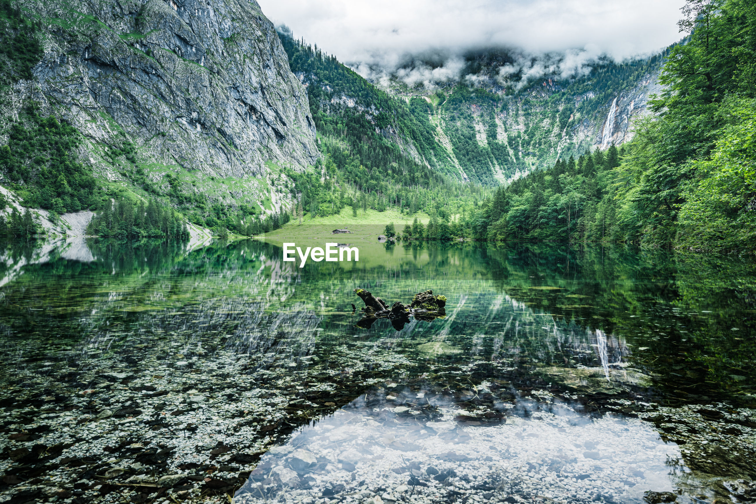 Atmospheric view of obersee lake and mountains, national park berchtesgaden, bavaria, germany