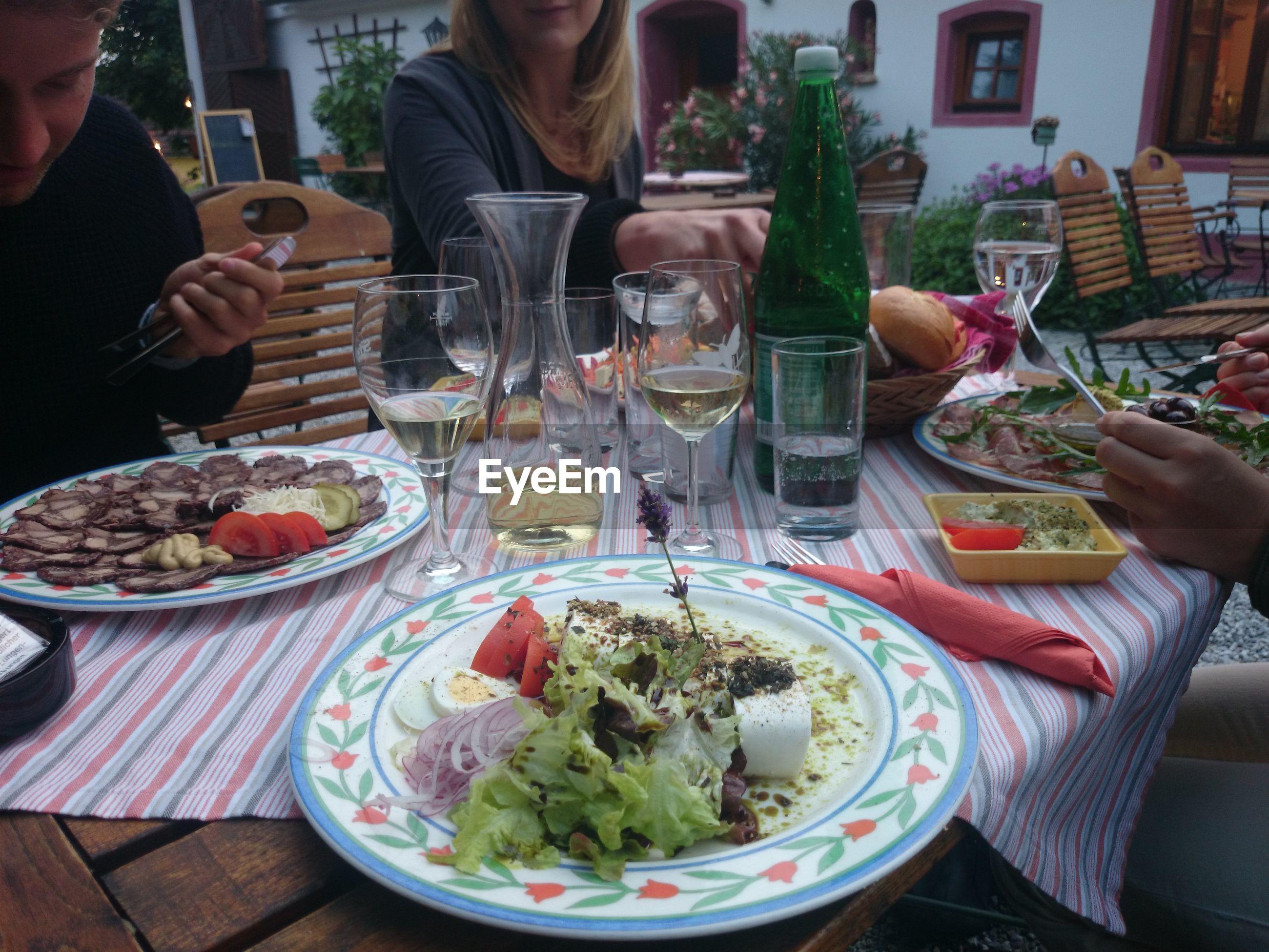 People having dinner outdoors