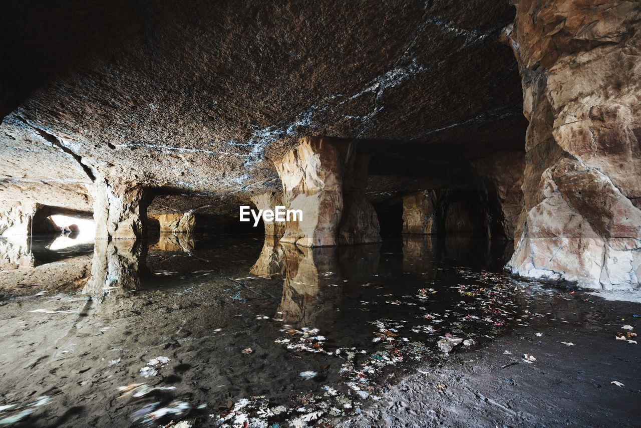 rock formation, cave, rock - object, indoors, no people, water, day, nature, architecture, beauty in nature