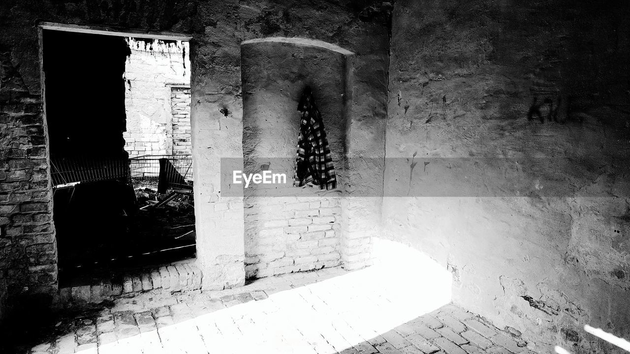 architecture, built structure, no people, day, building, wall - building feature, sunlight, indoors, entrance, the past, wall, door, history, old, religion, window, nature, shadow, tiled floor