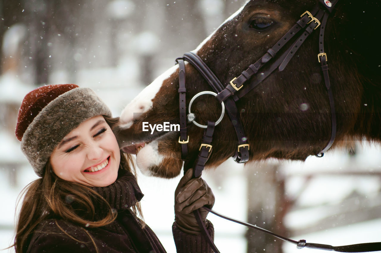 Close-Up Of Beautiful Woman With Horse On Field During Snowfall8