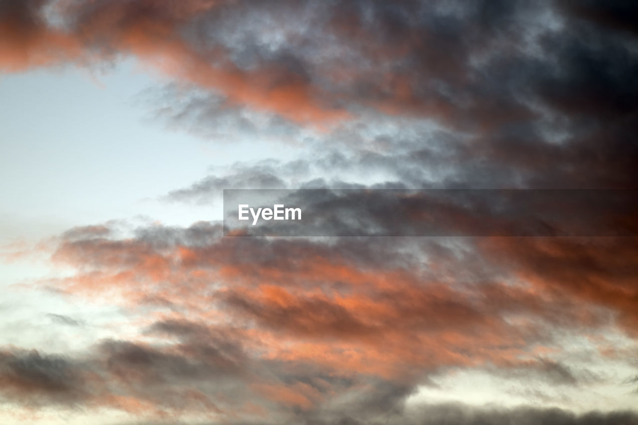 cloud - sky, sky, beauty in nature, sunset, orange color, scenics - nature, tranquility, low angle view, no people, tranquil scene, nature, idyllic, dramatic sky, backgrounds, outdoors, full frame, cloudscape, moody sky, overcast, meteorology