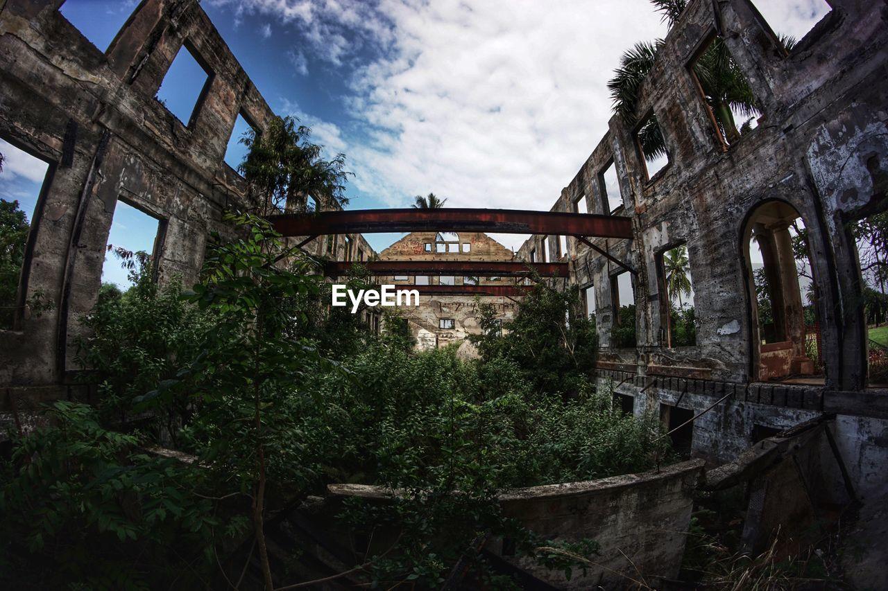 Fish-Eye Lens Shot Of Abandoned Building Against Sky