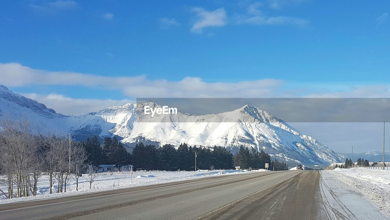 snow, beauty in nature, nature, road, sky, tranquil scene, scenics, winter, mountain, cold temperature, the way forward, tranquility, transportation, outdoors, day, cloud - sky, snowcapped mountain, landscape, no people