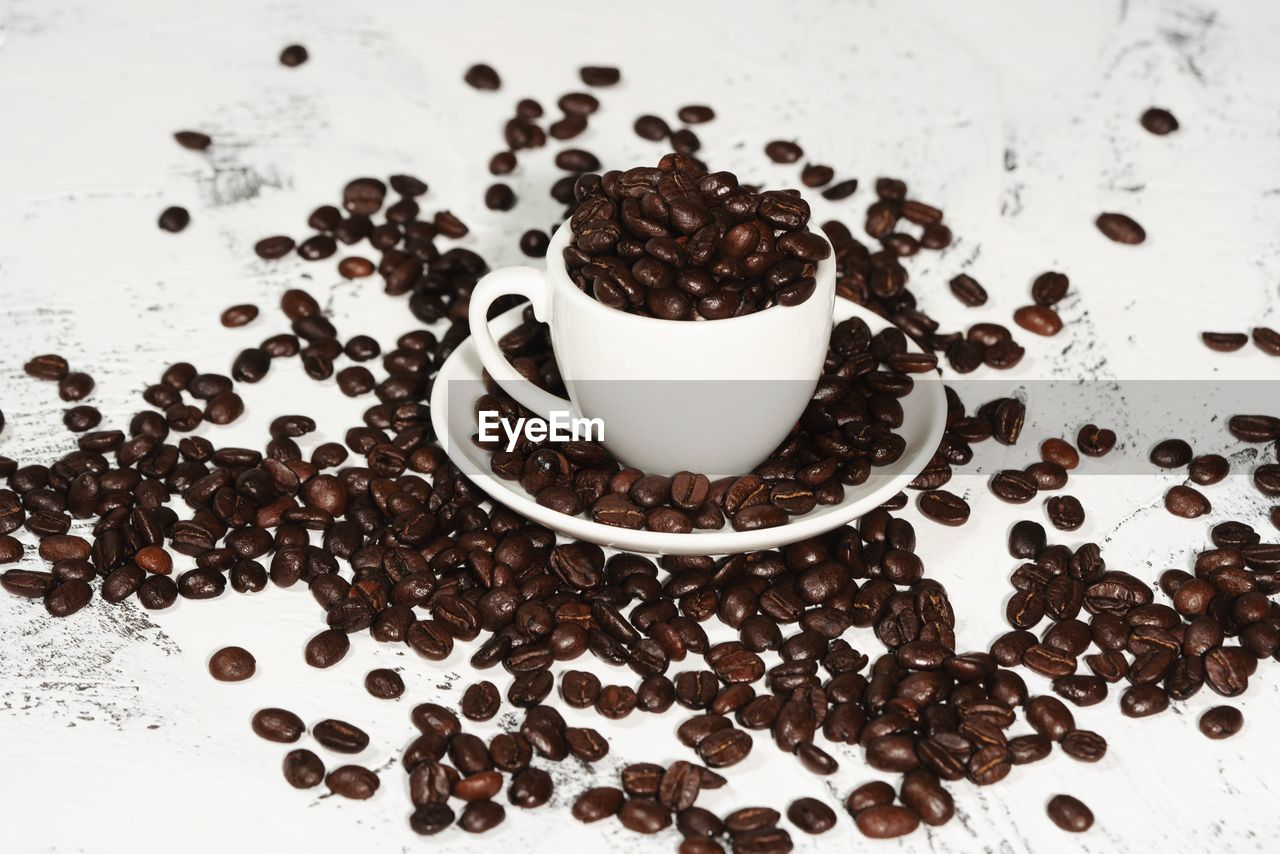 food and drink, coffee - drink, roasted coffee bean, coffee, coffee cup, cup, food, refreshment, freshness, drink, indoors, mug, still life, brown, no people, close-up, table, high angle view, coffee bean, large group of objects, caffeine, crockery, temptation
