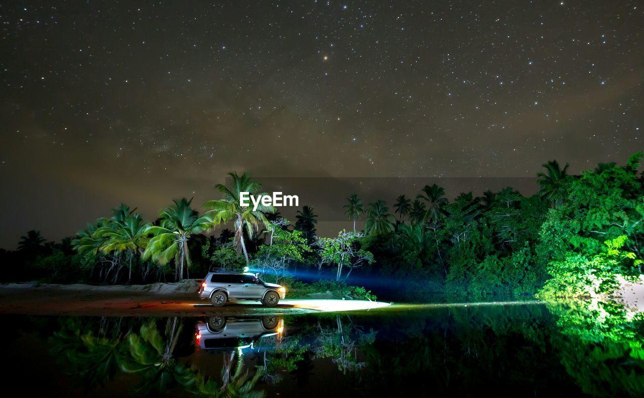Car parked at riverbank during night