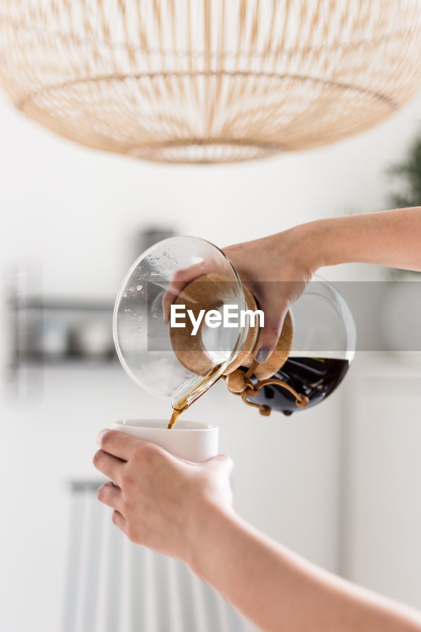 holding, drink, food and drink, refreshment, human hand, hand, one person, indoors, coffee, real people, coffee - drink, adult, cup, human body part, focus on foreground, women, freshness, mug, preparation, glass, finger