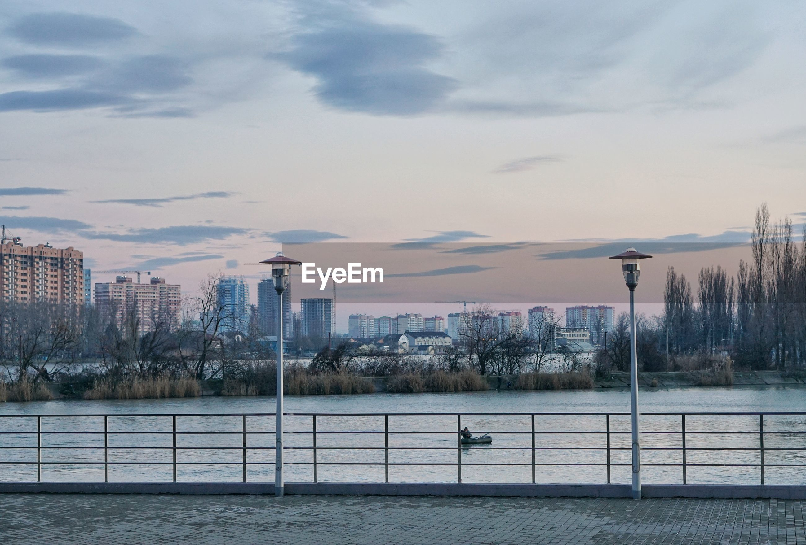 Scenic view of city against sky during sunset