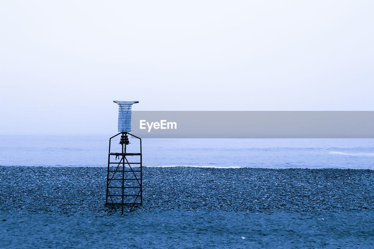 Navigational equipment on pebbled beach