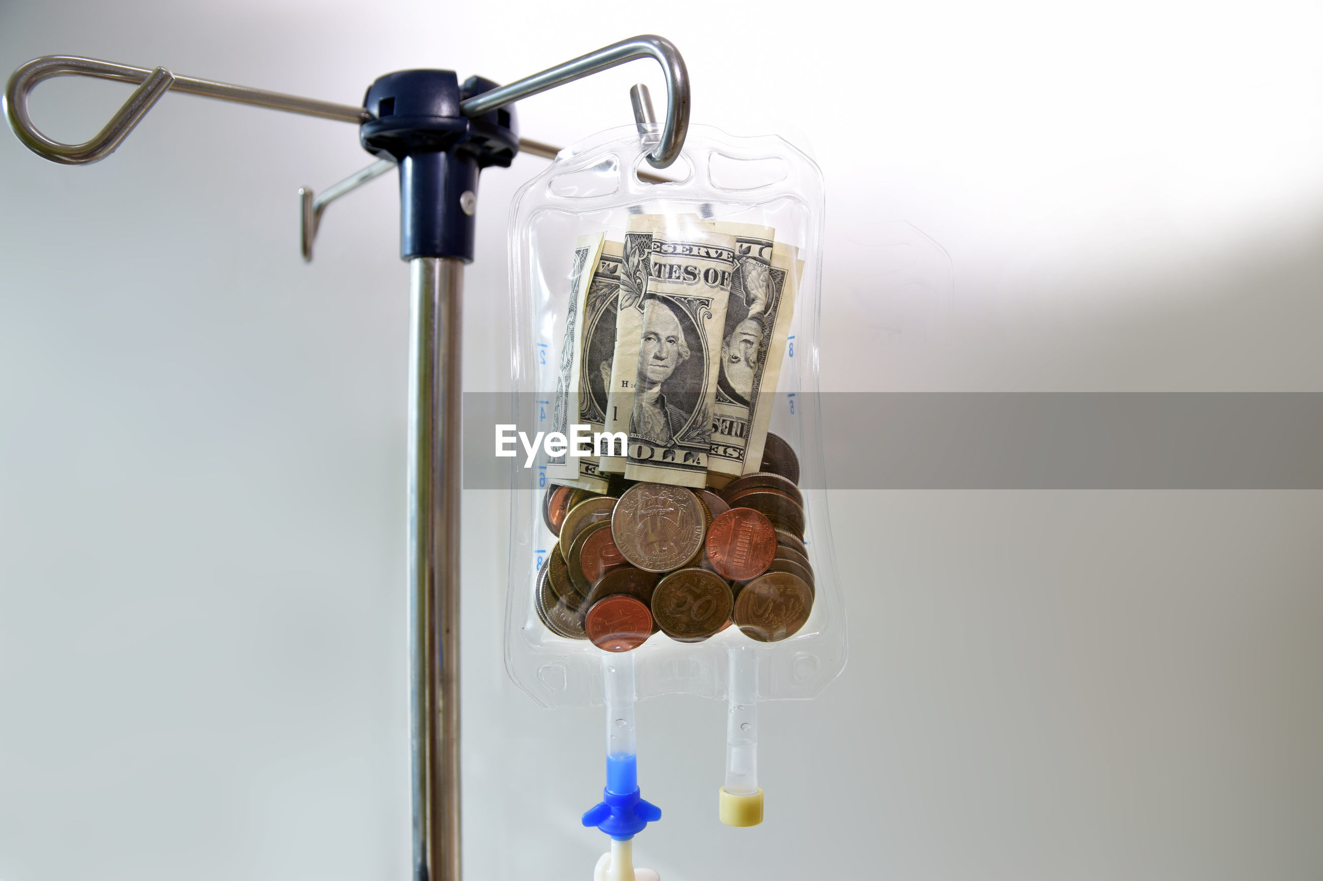 Close-up of currency in blood bag at hospital
