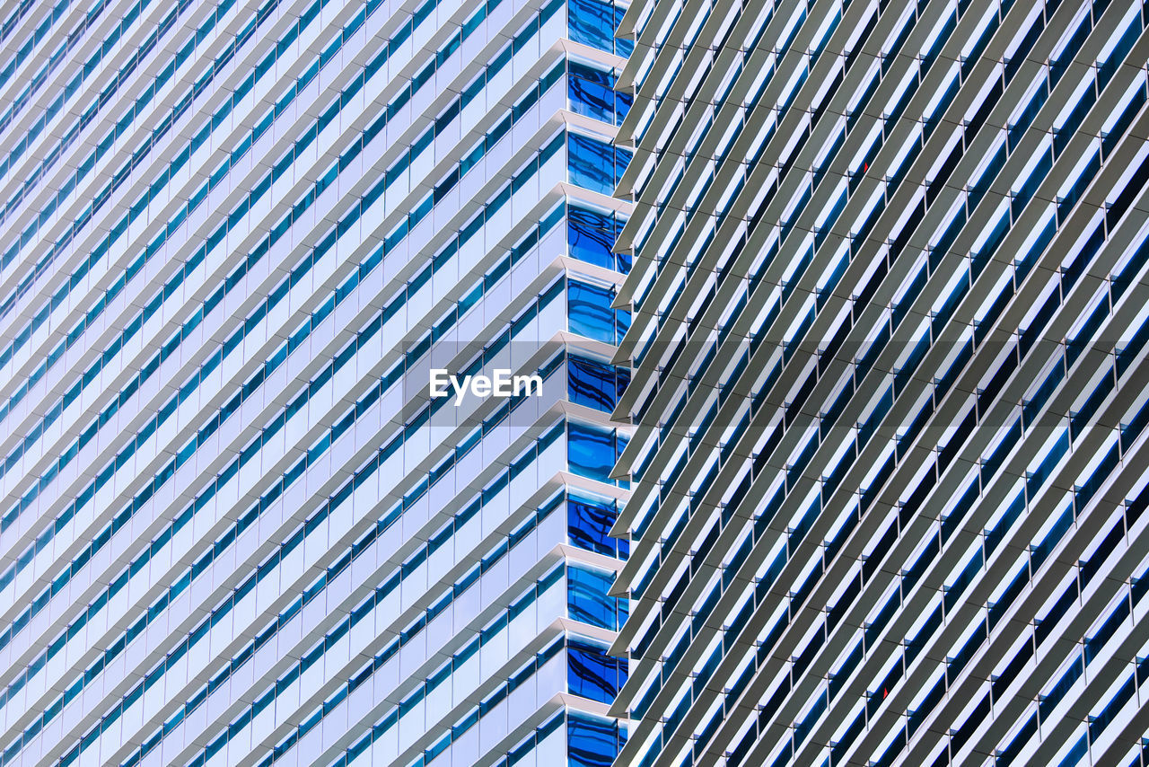 full frame, built structure, pattern, architecture, no people, backgrounds, building exterior, day, low angle view, metal, building, modern, blue, in a row, outdoors, side by side, nature, repetition, city, design, silver colored